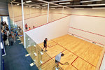 Playing squash on new courts